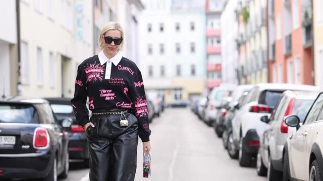 german tv and radio host verena kerth wearing a black pullover with pink colored lettering print by chanel, black leather pants by self-portrait, a... - pants stock videos & royalty-free footage