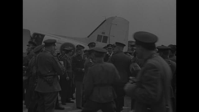 german warplanes parked in row on airfield / two shots of group of allied officers waiting for german field marshal wilhelm keitel's arrival / small... - arrendersi video stock e b–roll