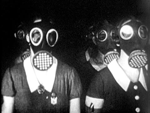 stockvideo's en b-roll-footage met german women in gas masks / germany - 1935