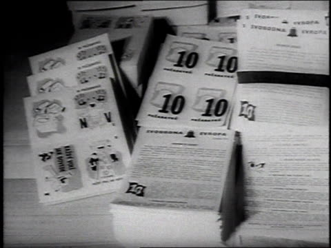 german women pack propaganda leaflets into balloons / bavaria - 1954 stock videos & royalty-free footage