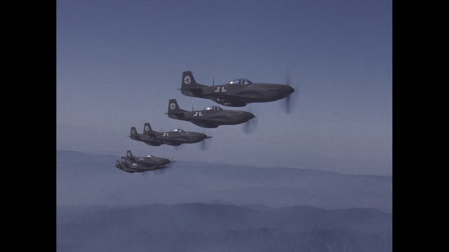 german wwii fighter planes fly in formation over mountains - luftwaffe stock-videos und b-roll-filmmaterial