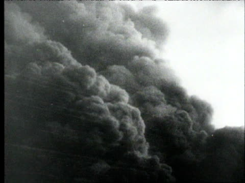 germans attack the russian oil district of mikof / fires burning, smoke plumes. nazi germany fighting the russians on september 18, 1942 in mikof,... - battaglia video stock e b–roll