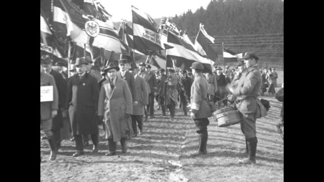 germans carry imperial flags through a crowd passing a piper drummer and a young man with a baton all wearing uniforms of the bismarckjugend /... - nephew stock videos and b-roll footage