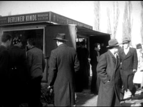 germans people crowded at market near frankfurter stand women shopping along market road w/ egg stand female behind stand picking out eggs putting... - west berlin stock videos & royalty-free footage