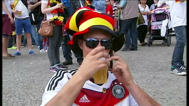 germans prepare to watch brazil 2014 world cup final against argentina; germany: berlin: ext low angle view german flag flying above reichstag... - headband stock videos & royalty-free footage