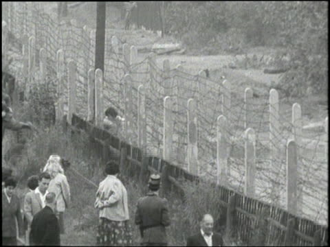 germans try to run through the newly formed berlin wall - 1961 stock videos & royalty-free footage