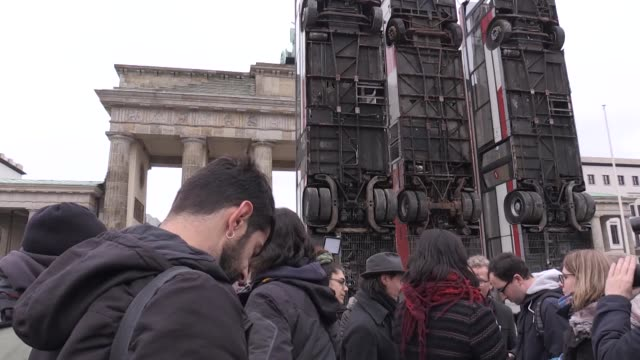 germansyrian artist manaf halbouni speaks too the press during the installation of his work 'monument' in front of the brandenburg gate on november... - artist stock videos & royalty-free footage