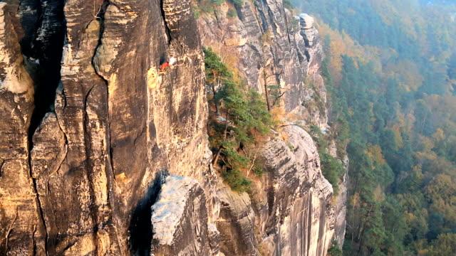 vidéos et rushes de germany abseiling climber male bastei rocks valley saxony  - vertige