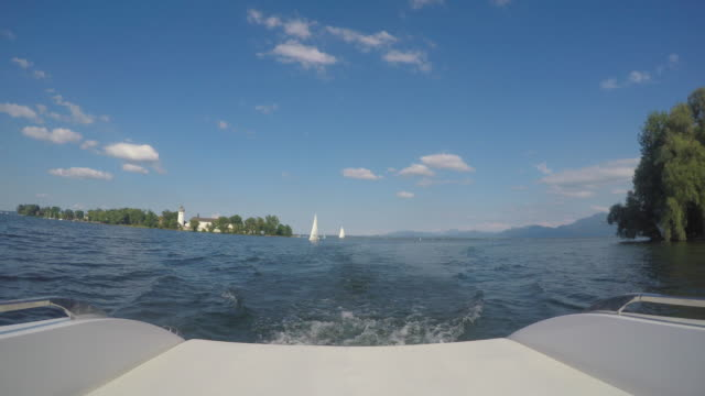 Germany, Bavaria, boat cruising on Lake Chiemsee near Island Frauenchiemsee or Fraueninsel