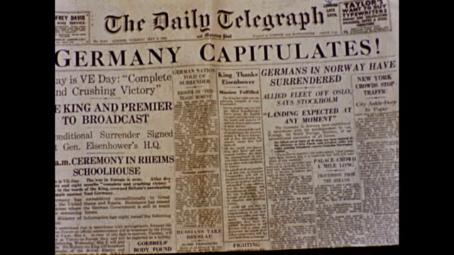 'germany capitulates' headline printed 5th may 1945 / celebrating victory in europe this clip was shot on the day in 16mm kodachrome - ve day stock-videos und b-roll-filmmaterial