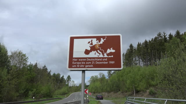 germany division of europe sign zoom in.mov - east germany stock videos and b-roll footage