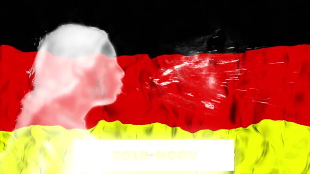 deutschland flagge mit frau niesen overlay. coronavirus hintergrundkonzept. - wachsamkeit stock-videos und b-roll-filmmaterial