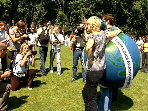 london protests demonstration scenes ure and annie lennox posing for photocall with man dressed as the planet earth / protestors wearing boxer shorts... - boxer shorts stock videos and b-roll footage