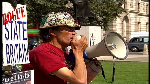 london protests england london parlaiment sqaure ext antipoverty demonstrators gathered in parlaiment square wearing only underwear and carrying... - g8 summit stock videos & royalty-free footage