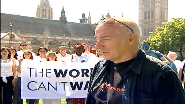 london protests england london westminster parliament square ext midge ure interview sot reporter to camera antipoverty demonstrators sing and dance... - underwear stock videos & royalty-free footage
