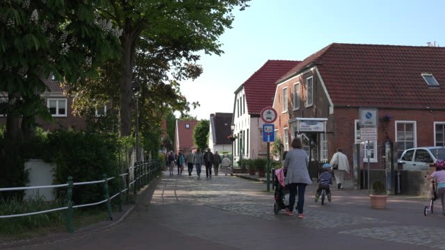 Germany Greetsiel mother and children walking in street