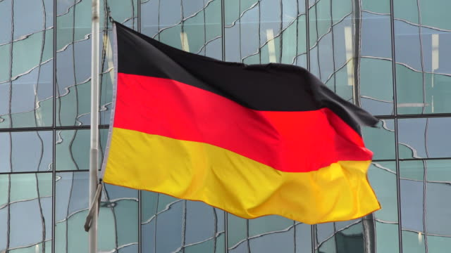 germany national flag waving or flying in the toronto city downtown, canada - german flag stock videos & royalty-free footage