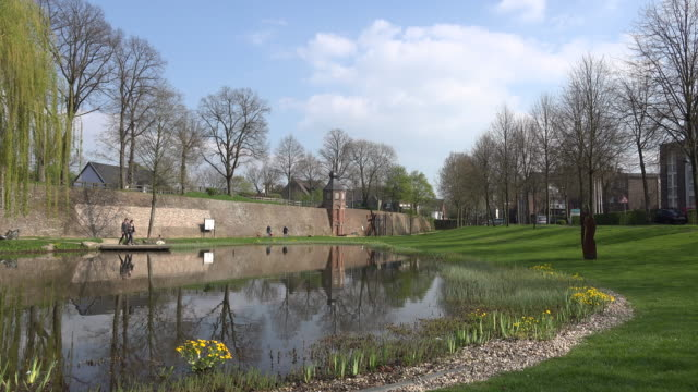 Germany Rees pond and medieval wall with cloud.mov