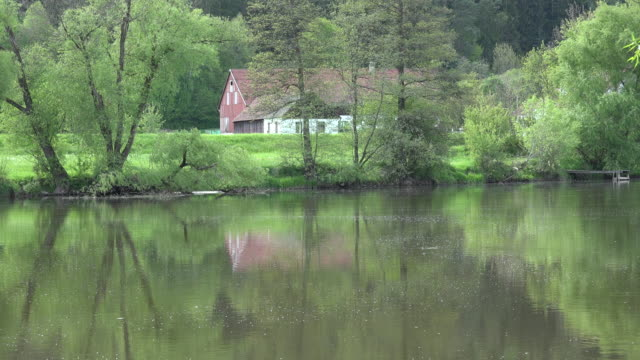 germany reflections of house in river - inn river stock videos and b-roll footage