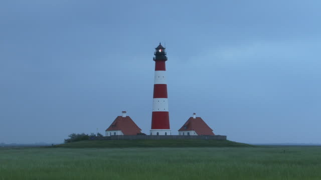 ms, germany, schleswig-holstein, westerhever lighthouse at dusk - schleswig holstein stock videos & royalty-free footage