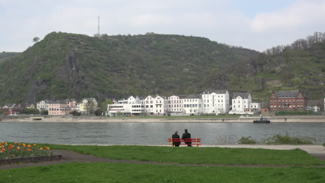 germany st goar men on bench by rhine - bench stock videos & royalty-free footage