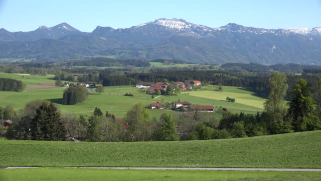 germany view of village and alps in distance - bavarian alps点の映像素材/bロール