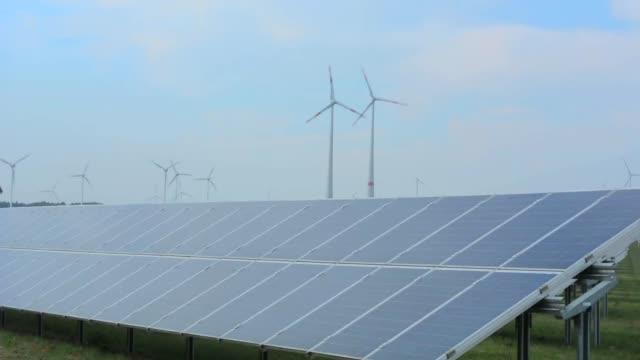 germany wind energy turbines and solar panels green ecology in field near hamburg - turbine stock videos & royalty-free footage