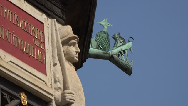germany wismar man statue and gargoyle detail on well. - bas relief stock videos & royalty-free footage