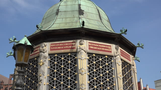 germany wismar man statue on covered water pumping station zooms in - water pumping station stock videos & royalty-free footage