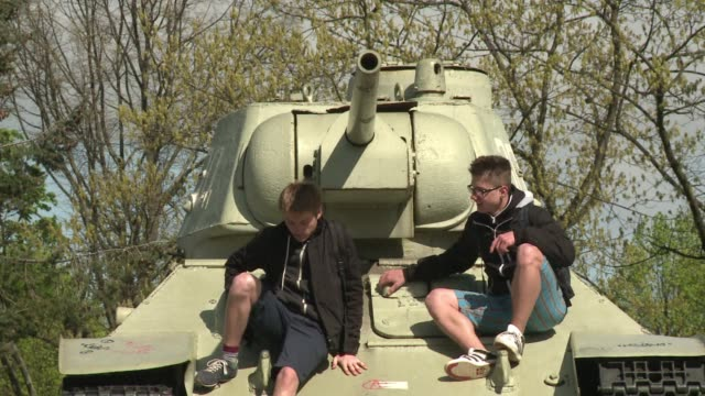 Germanys top selling Bild daily launched a petition Tuesday to remove two Russian tanks from a World War II memorial in central Berlin in protest...
