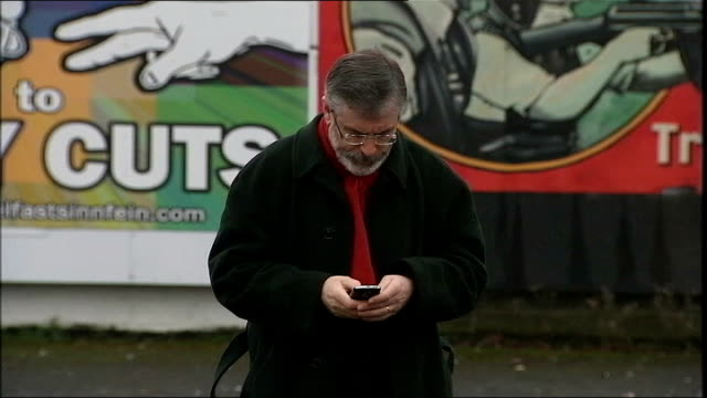 gerry adams accused of covering up his brother's abuse case day gerry adams along talking on mobile phone - gerry adams stock videos and b-roll footage