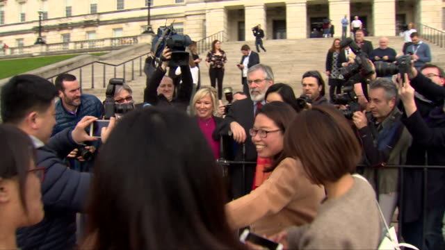 gerry adams and michelle o'neill posing for photographs outside stormont after sinn fein's best ever showing at the northern ireland assembly... - stormont stock videos and b-roll footage