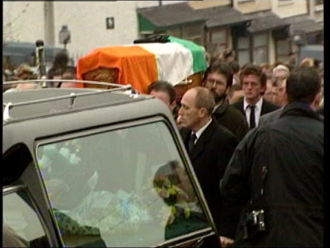 gerry adams carrying coffin at funeral of ira member - gerry adams stock videos and b-roll footage