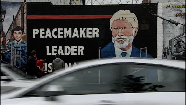 gerry adams held by police for third night over jean mcconville murder northern ireland belfast ext various of mural being painted on wall showing... - gerry adams stock videos and b-roll footage