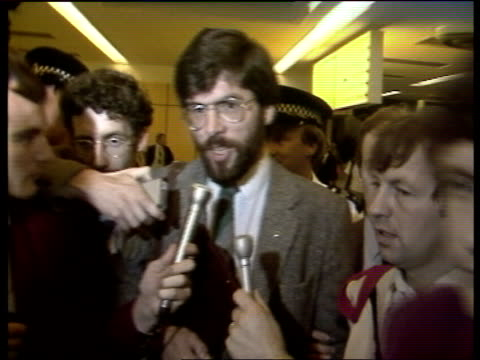 ms gerry adams and jo austin seated on plane england lap int lms both through into terminal with policeman as walk towards and greeted by steve... - 25 29 years stock videos & royalty-free footage