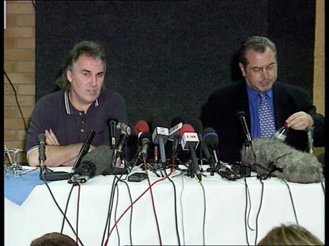 london white hart lane gerry francis alan sugar sitting down at table for pkf journalist sitting taking notes gerry francis pkf disappointed it... - alan sugar stock videos and b-roll footage