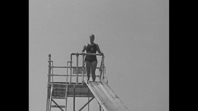 gertrude ederle standing at top of slide she goes down slide into pool / note exact day not known - gertrude ederle stock videos & royalty-free footage
