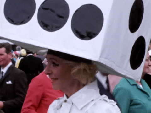 gertrude shilling wears an elaborate hat in the shape of a dice at royal ascot. - イギリス アスコット競馬場点の映像素材/bロール