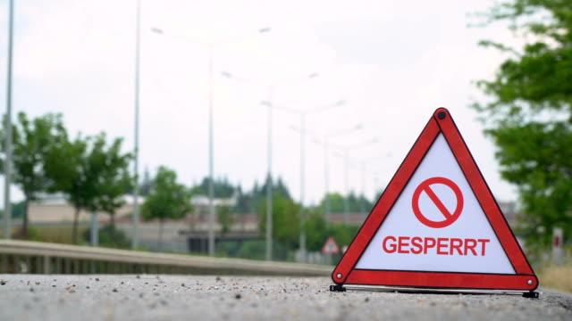 gesperrt (blocked) - traffic sign - german - road closed sign stock videos & royalty-free footage