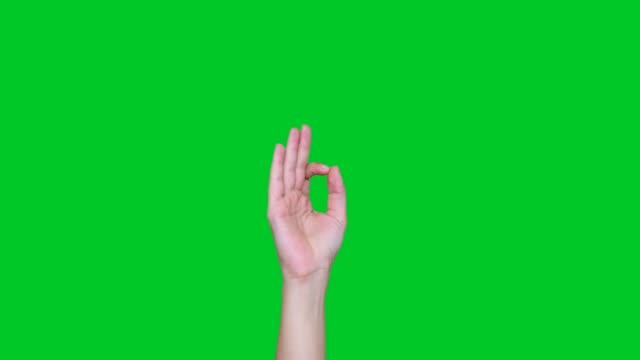 OK gesture signs on chroma key