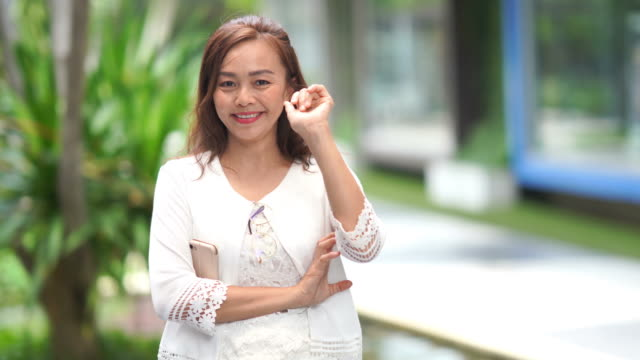 Gesturing by Asian luxury mature woman, beckoning sign , slow motion