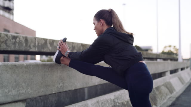 get limber, go longer - warming up stock videos & royalty-free footage