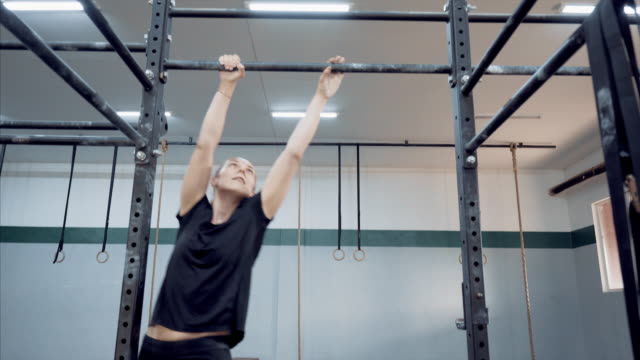 get out of comfort zone. - chin ups stock videos and b-roll footage
