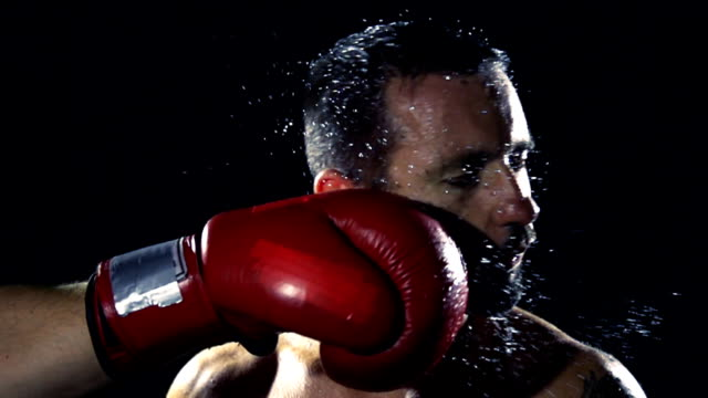 hd super slow mo: get punched in the face - sweat stock videos & royalty-free footage