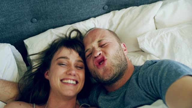 get the day started with a bit of goofiness - young couple stock videos & royalty-free footage