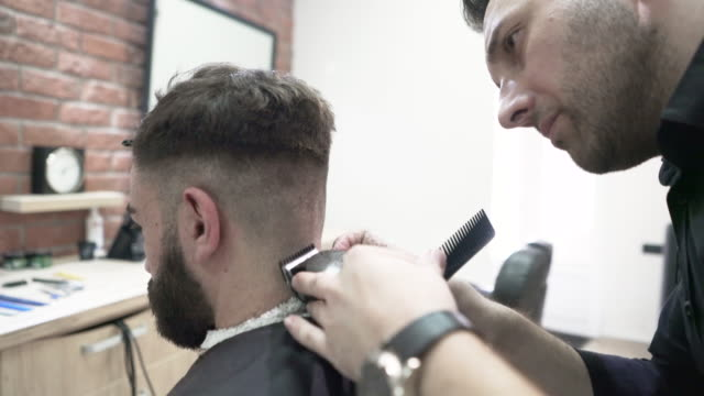 getting a shave - electric razor stock videos and b-roll footage