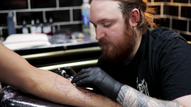 getting a tattoo - arm stock videos & royalty-free footage