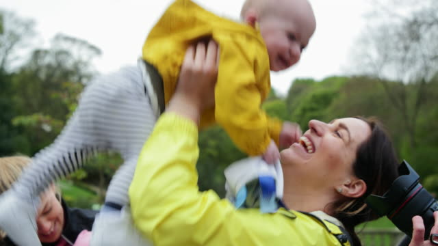 getting carried by mum outdoors - newcastle upon tyne video stock e b–roll