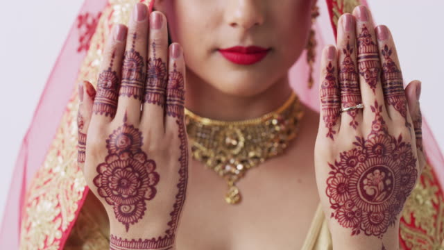 getting decorative for her big day - indian ethnicity stock videos & royalty-free footage