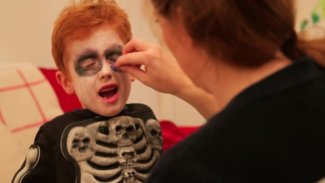 getting face painted for halloween - stage make up stock videos and b-roll footage
